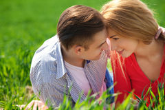 Young couple in love outdoor. They are smiling and looking at ea Royalty Free Stock Photography