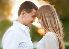 Young couple. In love outdoor. They are smiling and looking at each other Stock Photography