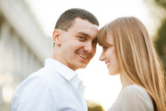 Young couple. In love outdoor. They are smiling and looking at each other Stock Images