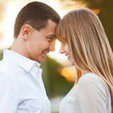 Young couple. In love outdoor. They are smiling and looking at each other Stock Photo