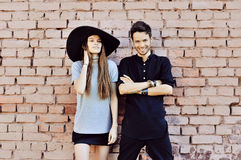 Young couple in love outdoor. Stunning sensual outdoor portrait. Of young stylish fashion couple posing near a wall Stock Image