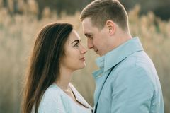 Young couple in love outdoor.Stunning sensual outdoor portrait of young stylish fashion couple posing stock photos