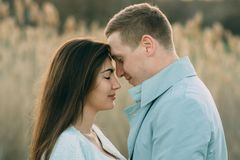 Young couple in love outdoor.Stunning sensual outdoor portrait of young stylish fashion couple posing stock photo