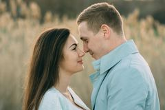 Young couple in love outdoor.Stunning sensual outdoor portrait of young stylish fashion couple posing stock image