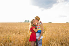 Young couple in love outdoor.Stunning sensual outdoor portrait of young stylish fashion couple posing in summer in field Royalty Free Stock Image