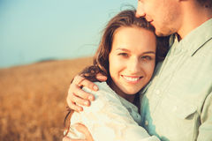 Young couple in love outdoor.Stunning sensual outdoor portrait of young stylish fashion couple posing in summer in field.Happy Smi Royalty Free Stock Photography