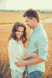 Young couple in love outdoor.Stunning sensual outdoor portrait of young stylish fashion couple posing in summer in field.Happy Smi Royalty Free Stock Image