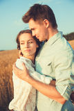 Young couple in love outdoor.Stunning sensual outdoor portrait of young stylish fashion couple posing in summer in field.Happy Smi Stock Images
