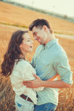 Young couple in love outdoor.Stunning sensual outdoor portrait of young stylish fashion couple posing in summer in field.Happy Smi Royalty Free Stock Photos