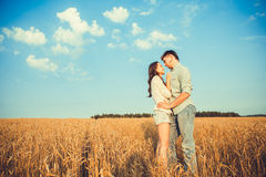 Young couple in love outdoor.Stunning sensual outdoor portrait of young stylish fashion couple posing in summer in field.Happy Smi Stock Image