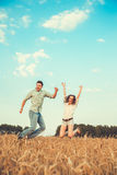 Young couple in love outdoor. Stunning sensual outdoor portrait of young stylish fashion couple posing in summer in field Stock Images