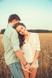 Young couple in love outdoor. Stunning sensual outdoor portrait of young stylish fashion couple posing in summer in field Royalty Free Stock Image