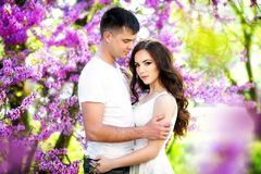 Young couple in love outdoor.Stunning sensual outdoor portrait of young stylish fashion couple posing in summer in field Stock Photo