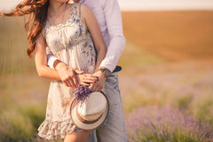 Young couple in love outdoor. Stunning sensual outdoor stylish fashion portrait of young couple posing in a field in summer