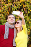 Young couple in love outdoor taking selfie. Love, relationship, season, friendship and people concept. Royalty Free Stock Images