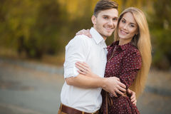Young couple in love outdoors in autumn in the park. Royalty Free Stock Photo