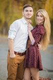 Young couple in love outdoors in autumn in the park. Stock Photography