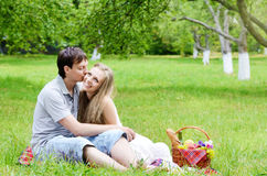 Young couple in love at picnic Stock Photos