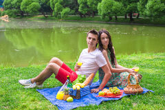 Young couple in love on a picnic outdoors Royalty Free Stock Photo