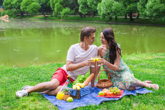 Young couple in love on a picnic outdoors Stock Photography