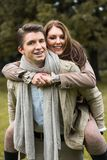 Young couple in love piggyback at a park Stock Photography