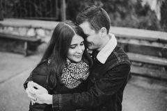 Young couple in love posing outdoors, black and white Royalty Free Stock Photo