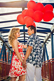 Young couple in love with red balloons Stock Images