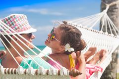 Young couple in love relaxing in a hammock by the beach stock image