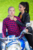 Young couple in love with retro motorcycle Stock Image