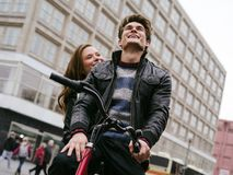 Young couple in love riding bicycle royalty free stock photos