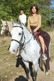 Young couple in love riding a horse Royalty Free Stock Photography