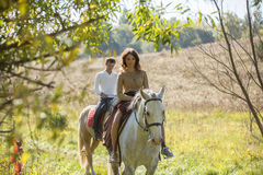 Young couple in love riding a horse Stock Images