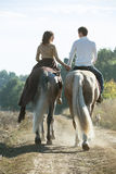 Young couple in love riding a horse Royalty Free Stock Photos