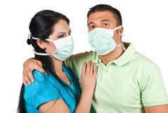 Young couple love safety. Young couple in love embracing but wearing protective mask also ,concept of protection from swine flu,check also  Medical Royalty Free Stock Images