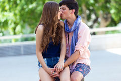 Young couple in love, sensual kiss in the street Stock Photo