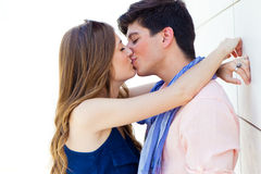 Young couple in love, sensual kiss in the street. Portrait of young couple in love, sensual kiss in the street Stock Images