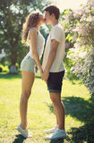 Young couple in love, sensual kiss. In sunny summer day Stock Photos