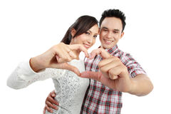 Young couple in love showing heart with fingers Stock Image