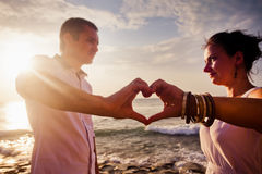 Young couple with love sign Royalty Free Stock Images