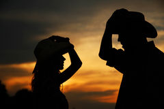 Young couple in love silhouette in cowboy hats Royalty Free Stock Photo