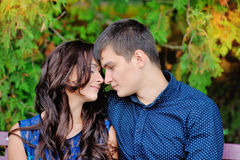 Young couple in love sitting on the bench, a romantic moment Royalty Free Stock Images
