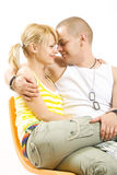 Young couple in love sitting on the couch Stock Photos