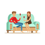 Young couple in love sitting on a light blue sofa. Young couple in love sitting on a light blue sofa and drinking wine, people resting at home vector Stock Photos