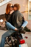 Young couple sitting on a motorcycle royalty free stock photo