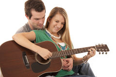 Young couple in love sitting playing guitar Royalty Free Stock Photography