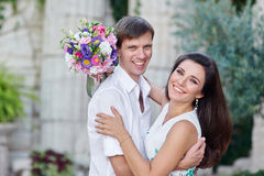 Young couple in love are smiling and looking at each other Royalty Free Stock Photo