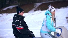 Young couple in love on snowmobile stock footage
