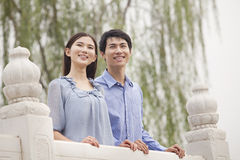 Young Couple In Love Standing on a Bridge Royalty Free Stock Images