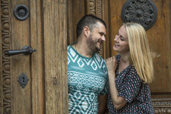 Young couple in love standing near the door of the old house. Stock Photos