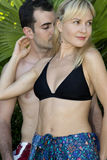 Young couple in love standing together in swimsuits Royalty Free Stock Photos